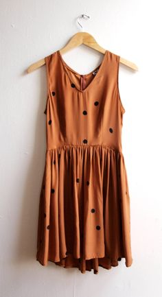 The perfect fall dress.  All it needs is a lace  boyfriend sweater and some knit tights :)