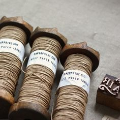 use vintage industrial bobbins to wrap and store twine