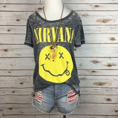 """[Boho Luxe] Nirvana Burnout Graphic Tee Cool Chic Classic soft burnout tee. Wide neckline. Short sleeves. Relaxed fit. Nirvana logo on front. You will want to live in this shirt!   Fabric: 55% Cotton 45% Polyester  Bust: 19"""" Length: 26"""" Condition: EUC. No flaws.  No Trades! Tops Tees - Short Sleeve"""