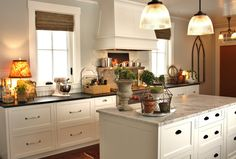 Wall color is Benjamin Moore Grey Owl, White is Benjamin Moore White Dove.  Kitchen is from a great blog!  I'll be visiting there often.