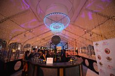 South Beach Food & Wine Festival 2015 Seminole Hard Rock Hotel & Casino at Meatopia: The Q Revolution: Seminole Hard Rock Hotel & Casino created a lounge within the tent to promote its new restaurant, Kuro. A chandelier by Designs by Sean and beaded curtains defined the space.