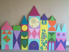 It's a small world party backdrop made by using 1/4 inch plywood, craft paint, and of course a projector