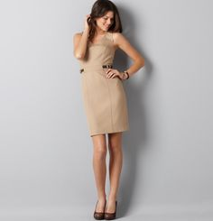 Dress with belt buckles.