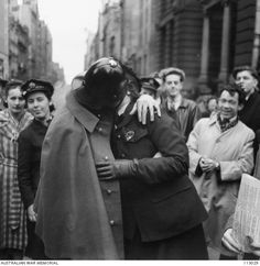 A member of the WAAAF (Women's Auxiliary Australian Air Force) kissing a policeman the VP Day (Victory in the Pacific) celebrations in the city of Melbourne.