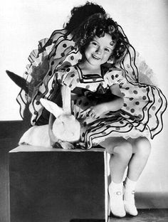 Shirley Temple with a bunny given her as an Easter present by Joel McCrea March 1936