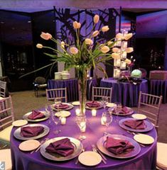 Purple linens and tall centerpieces