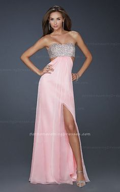 This Dress is perfect for a Prom Dress, Winter Formal Dress, or Homecoming Dress. This Strapless Dress features a beaded upper bodice, side cutouts, ruched bust line, and front slit. An open back with bead work and tie closure complete this look. http://www.hothomecomingdresses.com/