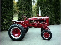 1945 Farmall A . Note the rear wheels are mounted in the widened stance. Also note the front wheel weights.