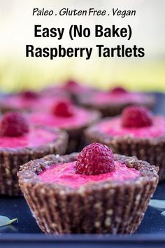 Easy raw raspberry tartlets. You will love this easy no bake dessert - bursting with raspberry flavour with a nutty cacao base. This paleo and vegan dessert is best made with frozen raspberries which means it can be enjoyed any time of year!#paleo #vegan #glutenfree #paleorecipes #nobake #nobakedessert #raw #rawvegan #rawfood #raspberry #tartelettes #dairyfreerecipes #vegandessert #nobake #veganrecipes #glutenfreedessert