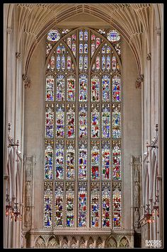The stained glass of Bath Abbey    The fantastically colourful stained glass inside of Bath Abbey, Bath, Somerset.