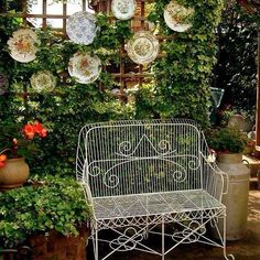 Here's a charming way to display plates in your garden. Love the trellis and ivy. Makes a pretty privacy fence too.