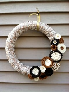 Christmas Wreath wrapped in Gold & Cream Ribbon decorated with felt flowers. Great for the Holidays. Holiday Wreath - Christmas Wreath. $42.00, via Etsy.