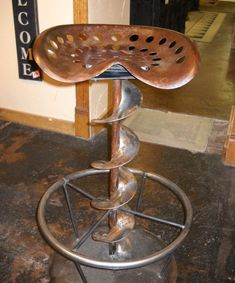 Tractor seat bar stool. Probably a couple of those lying around the farm.