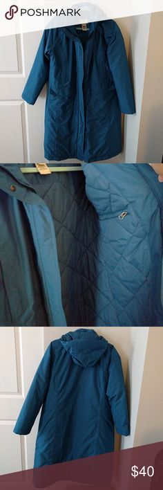 L. L. Bean heavy winter coat in perfect condition Dark blue coat with 4 pockets in the front and one stow away pocket inside.  Adjustable And supper removable hood.  Polyester and nylon synthetics keep you super warm!  Must sell make offer,  no low ball offers please.  Keep it profesh L.L. Bean Jackets & Coats
