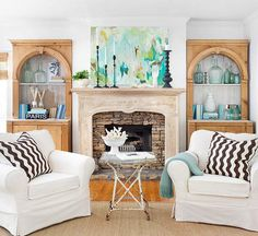 white / brown / blue / green living room, wood / stone fireplace {love everything about this}