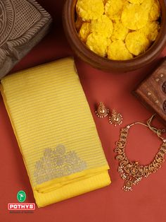 A Fascinating Handcrafted Vasundhara Silk Saree with double side even borders woven as a Kovai, having intricate designs in zari highlights the entire saree. Let the saree compliment your style with its unique motifs and designs. #yellow #silksaree #Pothys #Necklaceset