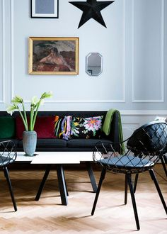 love the contrast between the soft baby blue walls and the dark and moody black furniture --LYC