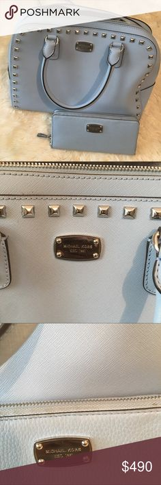 MK blue studded set Beautiful blue Micheal Kors set. 1,000,000% authentic. The purse still has the tags on it although I did wear both pieces a few times. EXCELLENT condition. 9.9/10. Needs to be wiped down on the outside of both the purse and the wallet. Insides are all clean and free of scratches, stains, rips. Please be mindful, you're basically getting a $168 wallet for free ☺️  ••  Happy shopping! 😀 feel free to ask any unanswered questions ❤️ Michael Kors Bags Crossbody Bags