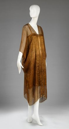 Two-piece Dress Mariano Fortuny y Madrazo, designer Spanish, 1871-1949 Two-piece Dress, 1926 Printed silk gauze-weave overdress embellished with glass beads; silk lamé underdress 59.031.7