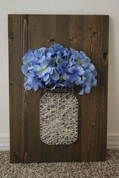 Mason jar with blue flowers. Dark brown background with beige string. Has hook on the back for hanging. Handmade by me. String Crafts, Jute Crafts, Fun Diy Crafts, Creative Crafts, Arts And Crafts, Friend Crafts, String Art Patterns, Crafts With Pictures, Sola Wood Flowers