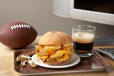 The Big Game: Deli roll with Smooth Operator peanut butter and jalapeño jelly stuffed with tortilla chips and and wedges of sharp cheddar cheese.