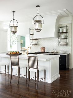 The former study became a new kitchen, where details like the plaster hood reference the original architecture. Chairs, Holland