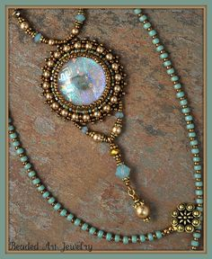 I created this piece using one of my fused Dicrhoic glass cabochons for the center and bead embroidered around it with seed beads and Swarovski Glass Necklace, Glass Jewelry, Beaded Necklace, Beaded Bracelets, Beaded Bead, Necklaces, Bead Embroidery Jewelry, Beaded Jewelry Patterns, Beaded Embroidery