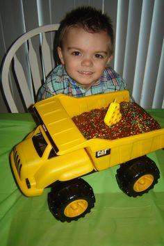 Dump truck birthday cake!!  So fun for a little boys birthday party!  Dump truck cake.