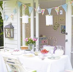 Hold a party for friends and family by dragging a trestle table out into the garden and decorate with vintage linen, pressed glass tableware and accessorise with mismatched cushions. Party into the evening with tealights in old jam jars and fairy lights running alongside the bunting.