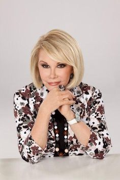 Joan Rivers...she is very pretty in this photo, and love the jacket and the jewelry