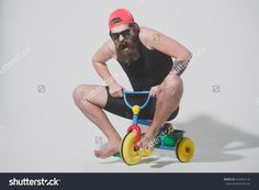 stock-photo-bearded-man-long-beard-brutal-caucasian-hipster-with-moustache-in-black-vest-and-red-cap-626495114.jpg (1500×1101)