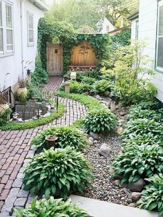 Side-Yard Solutions pretty little leafy side garden.with cobblestone and brick and hostas and climbing vines!pretty little leafy side garden.with cobblestone and brick and hostas and climbing vines!