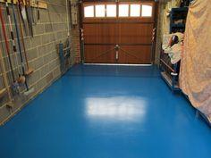 blue painted garage floor with epoxy flooring flooring ideas floor design trends