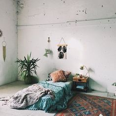 Would love a bedroom with the mattress on the floor and plants around my bed
