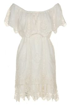White Lacy Dress and Cowgirl boots.