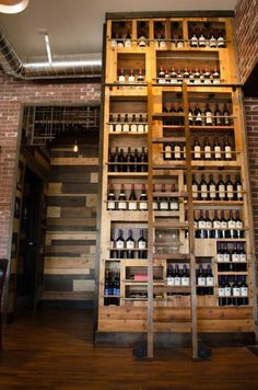 make the most of vertical spaces with ladders Wine And Liquor, Wine And Beer, Library Ladder, Library Wall, Wine Bistro, Liquor Storage, Whiskey Room, Whisky Shop, Wine Display
