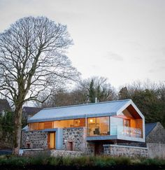 This conversion in the Irish village of Broughshane started out with something that was already truly an object of beauty: a crumbling old stone barn. With some clever manipulation, they turned the old barn into a light-filled, contemporary living space.