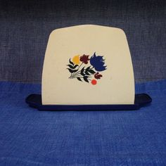 Vintage Plastic Napkin Holder by TrailerTiques on Etsy https://www.etsy.com/listing/231712336/vintage-plastic-napkin-holder