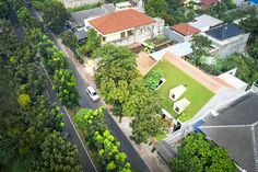 RAD+ar tops tropical residence in indonesia with green steep pitch roof