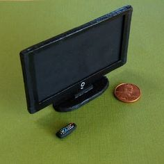 Image of miniature television and remote control - click through to blog for other dollhouse-sized modern minis