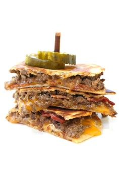 Bacon Cheeseburger Quesadillas are loaded with a cheesy, hamburger filling covered with bacon and tons and tons of cheese!