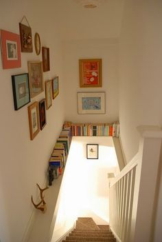Great space saver/decoration idea. Display books in your stairwell! …