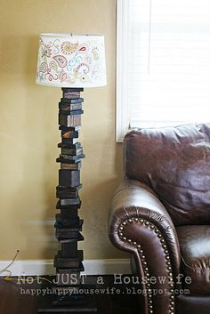I think this scrap wood floor lamp is da bomb.  via Not Just a Housewife