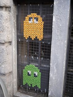 Cross-stitched Pac Man street art - I think I can enlarge that image and make a pattern Cross stitch is kind of like original 8-bit anyway so shouldn't be to hard