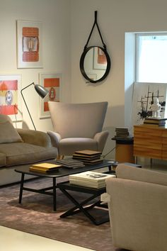 From left to right - CONTENT BY CONRAN, Berkshire 3 seater sofa in fabric B - Redbourne (Mystere) Puffy Wenge. GUBI, Grossman Grasshopper Floor Lamp, anthracite gray.  CONTENT BY CONRAN, Duchess armchair. GUBI, ADNET mirror in BLACK LEATHER. CONTENT BY CONRAN, wave sideboard in Oak & Stainless steel legs. All items available at Dream Interiors!