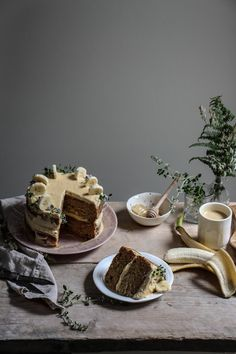 banana thyme honey cake with brown sugar frosting and blonde chocolate drizzle