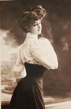 """The """"Belle Epoque"""" period runs from about 1890-1914. This particular photograph is probably early Edwardian, around 1905. Womenswear became very frothy and ornamented, with oodles of lace and frills spilling from the clothes, especially on petticoats and blouses, as you can see here.    Her high-piled hair is typical of the """"Gibson Girl"""" look.    This picture also really exemplifies the S-bend corset shape that was popular in this period- look at the curve of her back!"""