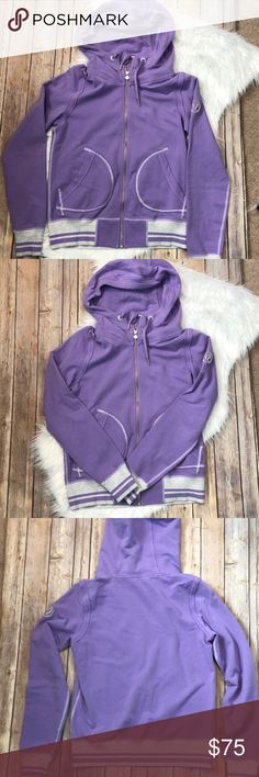 Purple Lululemon Hoodie Size 8 Lululemon hoodie in excellent condition. Purple with grey and purple striped cuffs and bottom. Rip tag still intact. lululemon athletica Tops Sweatshirts & Hoodies