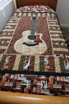 Guitar quilt! So realistic, my mom traced my son's actual guitar to make this!! Amazing