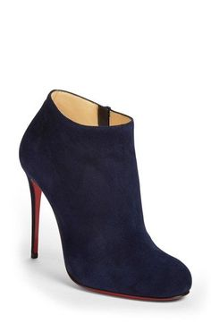 Free shipping and returns on Christian Louboutin 'Bellissima' Round Toe Bootie at Nordstrom.com. A slender wrapped heel sends a sleek round-toe ankle bootie sky high, creating a deliciously long leg line, while Christian Louboutin's iconic red sole—born from a fateful brush with red nail lacquer—pops beneath the exquisite silhouette.